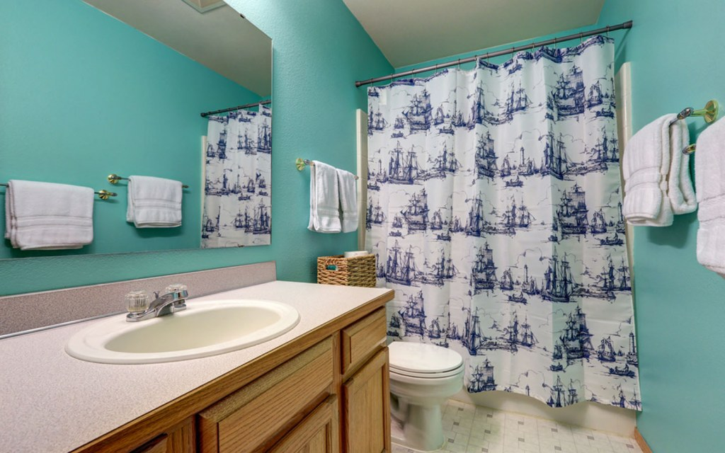 measuring the ideal length for shower curtains